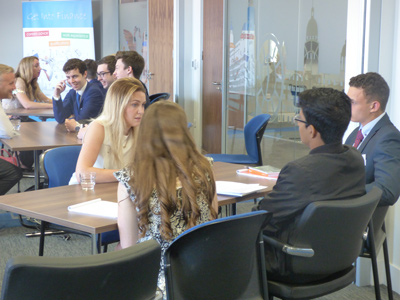 "Groups of students ""Speednetwork"" with local practitioners at the CISI Careers in Investment Management conference at Tilney Bestinvest, Liverpool"